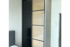 Modern and contemperory sliding wardrobe design with black frame available in Bestmas Furniture Desgin