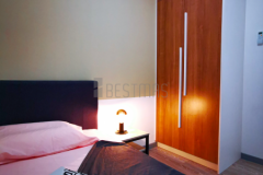 12.-Bedroom-2-with-Queen-size-Bedset-and-Swing-Door-Wardrobe-design